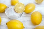 Natural cleaners lemons and baking soda on the table